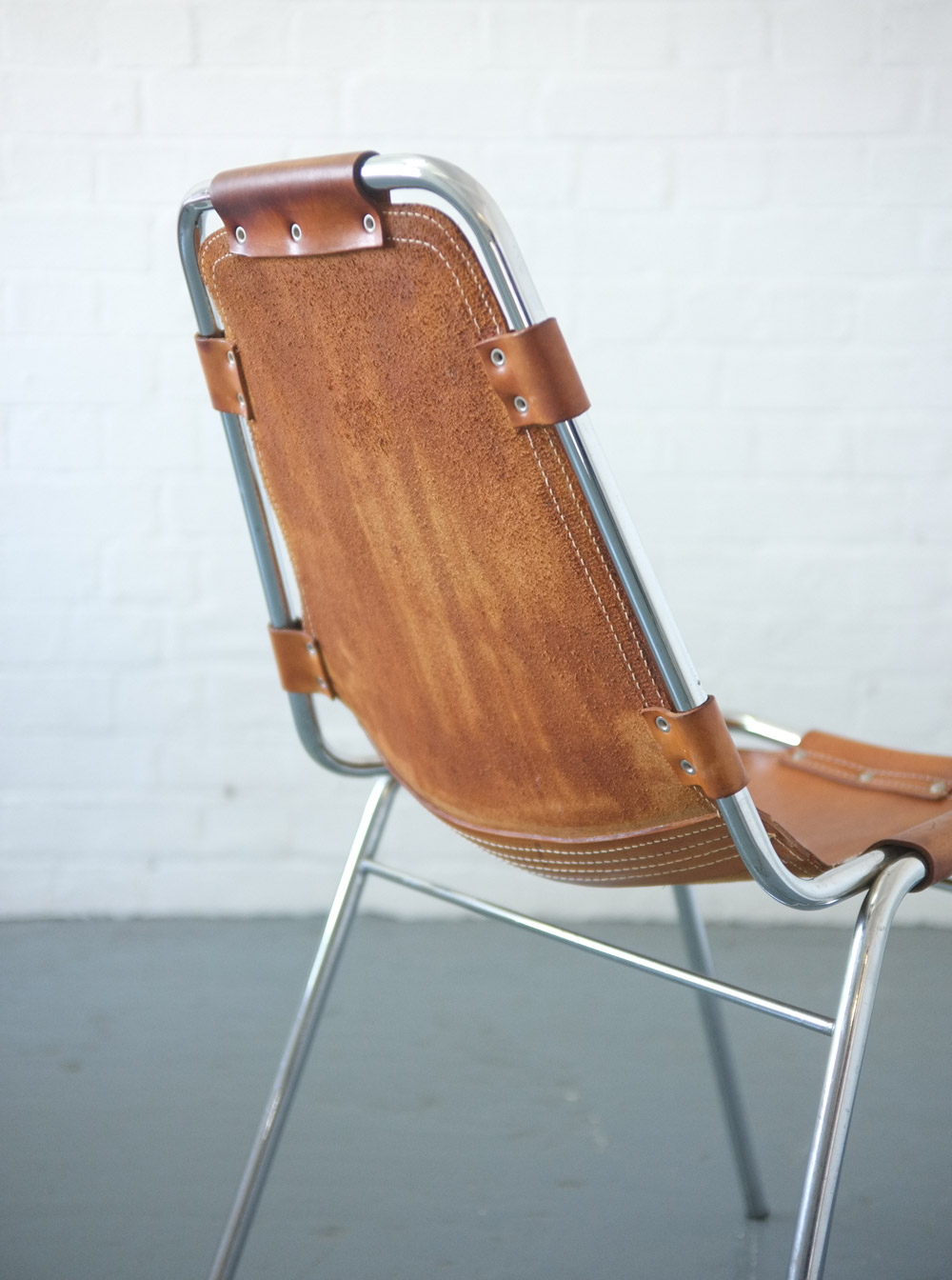 Set of four Charlotte Perriand Les Arcs chairs in Cognac brown leather